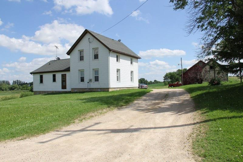 Come to the country & enjoy 7 acres, pond views, & a 28x70 outbldg. that boasts an 8x7.5 ft. overhead door, as well as a 10x7.5 ft. overhead door.  2 sets of 8x7 sliding doors offer a 15 ft. wide opening.  3 BR farmhouse offers 2 main floor BR's, main floor bath & laundry room.  Upstairs features a 3rd BR, loft & great attic storage space too.  Subject to Town of Herman land split approval.