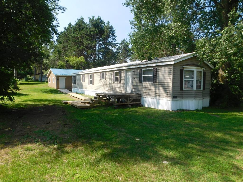 2 Bed/1 Bath 1998 Wick Rollohome Located North of Menomonie. Home Features Open Concept with Vaulted Ceiling in Kitchen/Living Rooms. Large Bedroom has Walk-In Closet. Detached 24 x 24 Garage was Built in 2015 and is Insulated w/LP Heater Not Yet Installed. Spectrum Cable/Internet Service Available. Natural Gas Available.