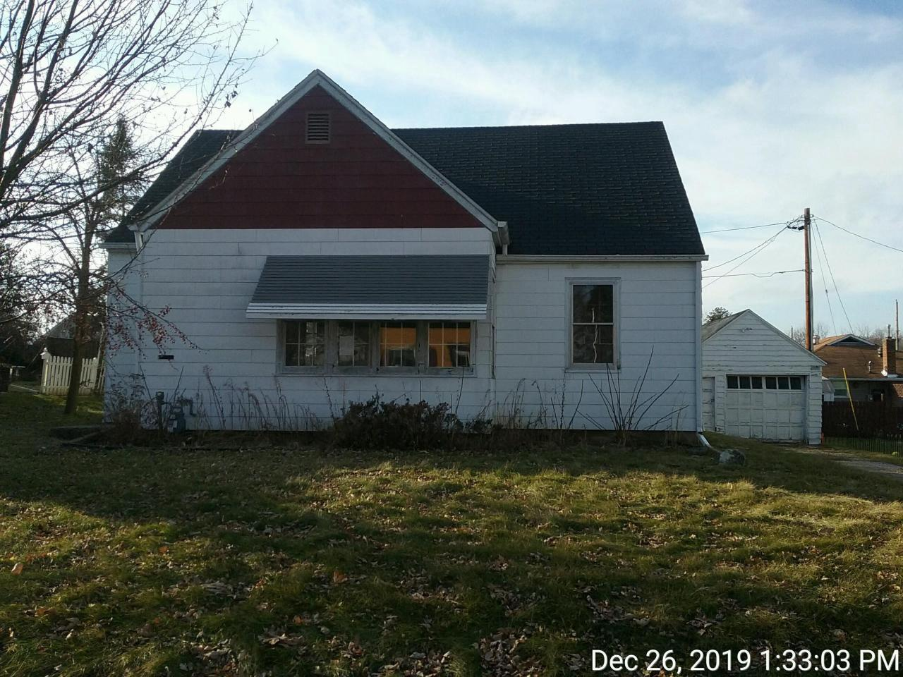 Cute 2 bedroom home! Some wood flooring, expandable attic for more living space. Great location close to schools and down town.  Property is winterized. Furnace is not working and cannot be dewinterized.