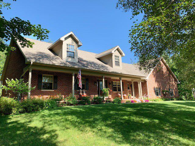 This beautiful custom-built exposed ranch is maintained meticulously! The home features hardwood floors & an air purification system. Walk into the kitchen & you will find a natural stone back splash, granite center island, corian counter tops, a built-in birch buffet, & birch cabinets with under cabinet lighting. The master bathroom is a place for you to relax and pamper, featuring a welcoming bathtub & well-lit vanity. The garage has extra high ceilings -great for storage. Walking out onto your back deck, you will be amazed. Five acres of green, wooded land surround you. Horse friendly.