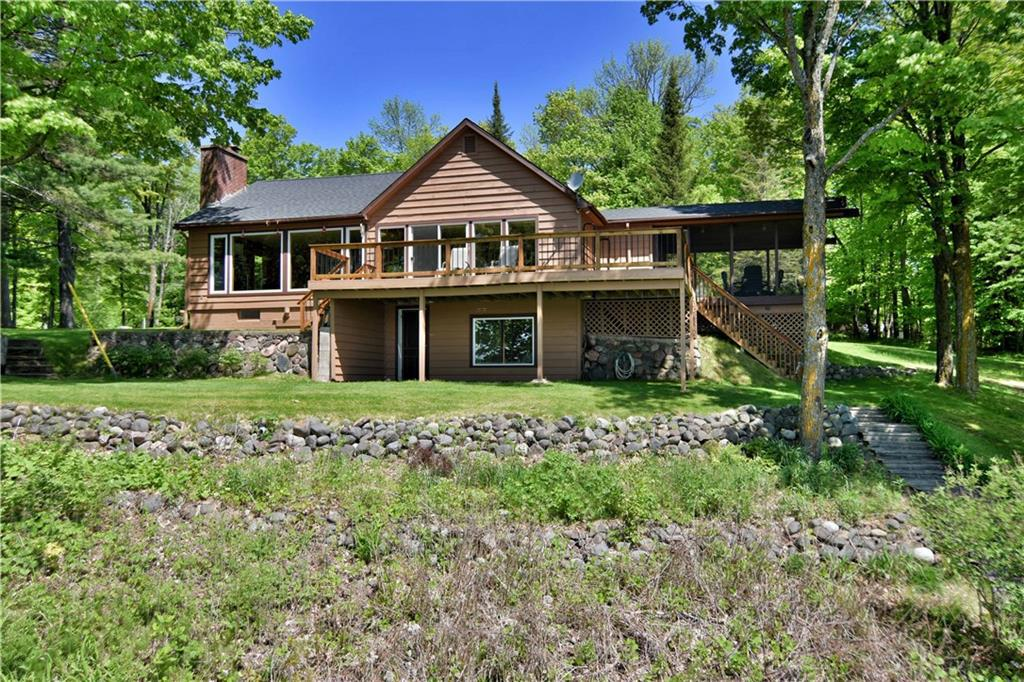 Home and guest cabin takes advantage of one of the most picturesque views on Lake Namekagon with south east exposure. Watch the sunrise from the large screen porch or your living room. Large 1.48 acre lot with 395 feet of meandering frontage for a private setting. Plus a large 32 X 44 insulated garage with 4 overhead doors and a 17 X 12 boat house at waters edge.  Think of all the possibilities.