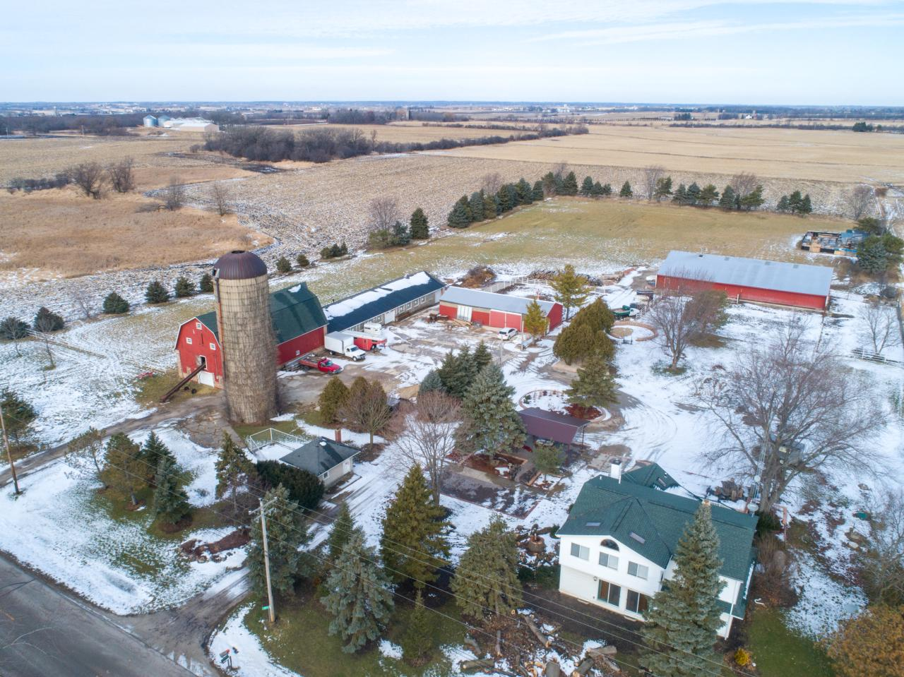 Located approximately one mile west from the upcoming Foxconn company campus! Perfect opportunity for potential developers to utilize this 7.88 hobby farm parcel with numerous outbuildings, and a 1920 remodeled farmhouse. Also included is a 120x60 pole barn zoned for commercial usage.