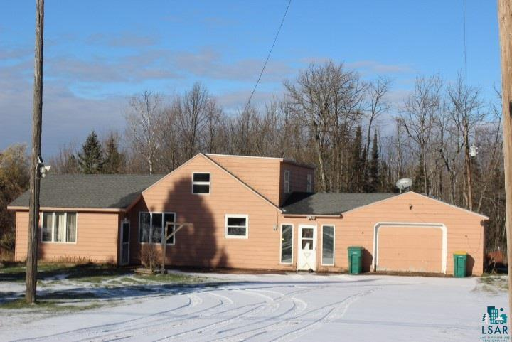 Need Room to Roam? This 3BR home is on 20 acres just minutes from town. Breezeway, formal dining, open living room, main floor bedroom + bath, rec room, attached 2 car garage, 30x46 pole building & chicken coop. Would make a great hobby farm!