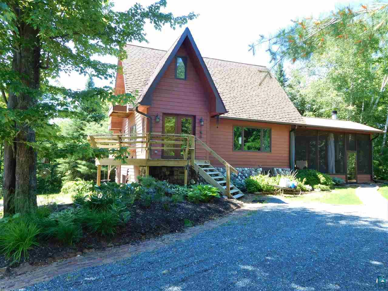 Stunning home with continual wow-factor inside & out! Nestled in the hills of Bayfield this three-bed, three-bath, two-car garage home has two-fireplaces, 15 KW entire home backup generator with newer mechanicals, well, septic and many other updates, a must-see indoor/outdoor room with vaulted ceiling, acre-wide pond, huge pole-barn that contains a finished guest room w/kitchenette, two-finished work/hobby spaces and enough room to store boats, tractors, RV's, vehicles and extra storage space. So many thoughtful, modern updates create warm & comfortable spaces in every area of this home. Numerous decks offer brilliant views of the surrounding countryside and Lake Superior.  A gorgeous kitchen opens into the family room and dining area, and the upstairs Master bedroom has the ultimate in luxury with an attached bath, walk-in closets, laundry and soaking tub. Lower-level media room can also be used as an office with a separate entrance.  Just minutes to downtown Bayfield and the surrounding orchards and wineries - this is a home and area you'll treasure!