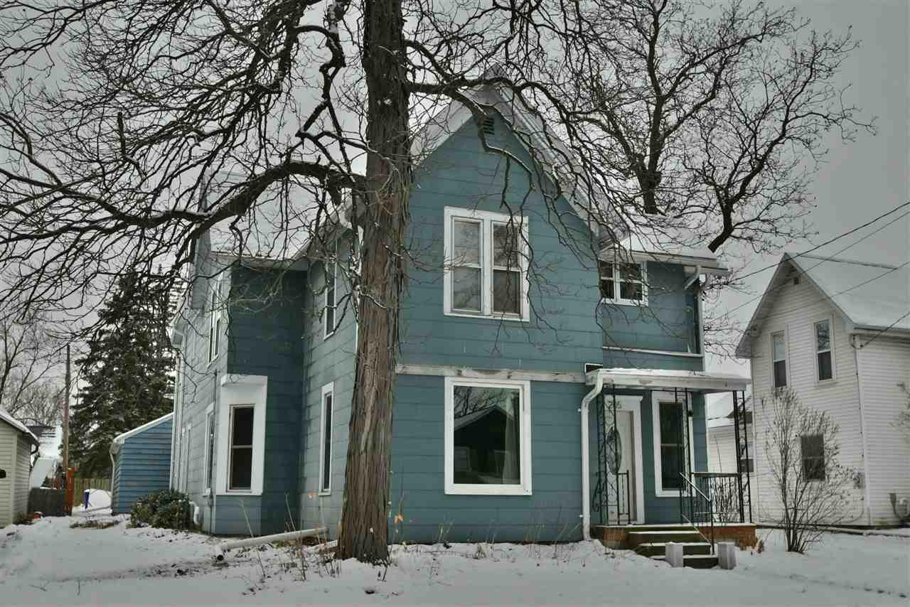 Tons of character with charming hardwood floors, woodwork, open staircase, and tall ceilings...all maintained with nice/tasteful updates! Plenty of space on the first floor, including kitchen w/island, formal dining, living room, master bedroom, full bath, and laundry room. Upper level includes a family room, 2 good sized bedrooms, full bath, and another kitchen and dining area. Must see to appreciate! Move-in ready with appliances for both kitchens and washer and dryer included. Not a big yard, but less than 2 blocks from Horseshoe Park. Electric heat on upper level; slate/asbestos siding.