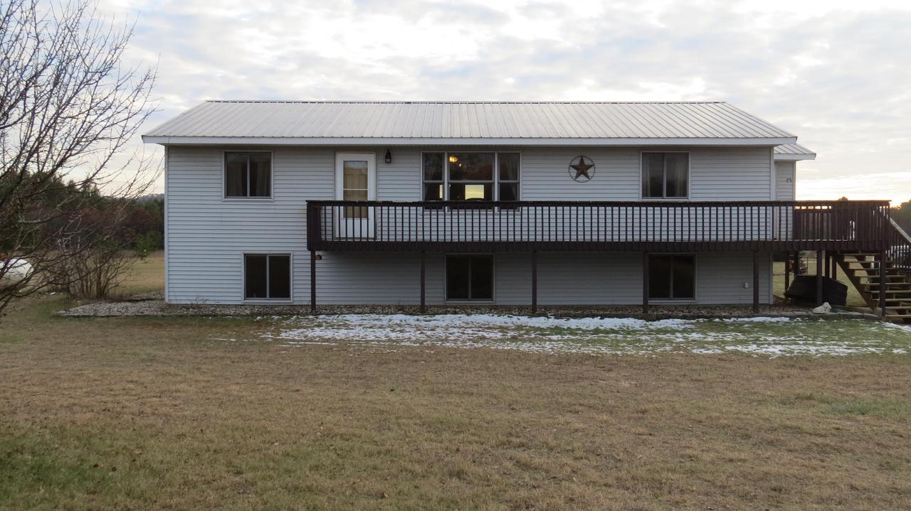 Here's an opportunity to own a spacious 5 bedroom, 3 bath home on 6 acres!  Many updates throughout the home include flooring, paint, kitchen counter tops, newer roof, and brand new basement bathroom!  Property adjoins to 80 acres of Public Hunting Land with Soper Creek running through it.  Wonderful country views from the new back deck which oversees a horse run-in barn and 4 acres fenced with 4 lines of barbless twisted wire. Oversize 36x30 garage with two doors.  Great recreational property in a very desirable location and a horse lovers dream.