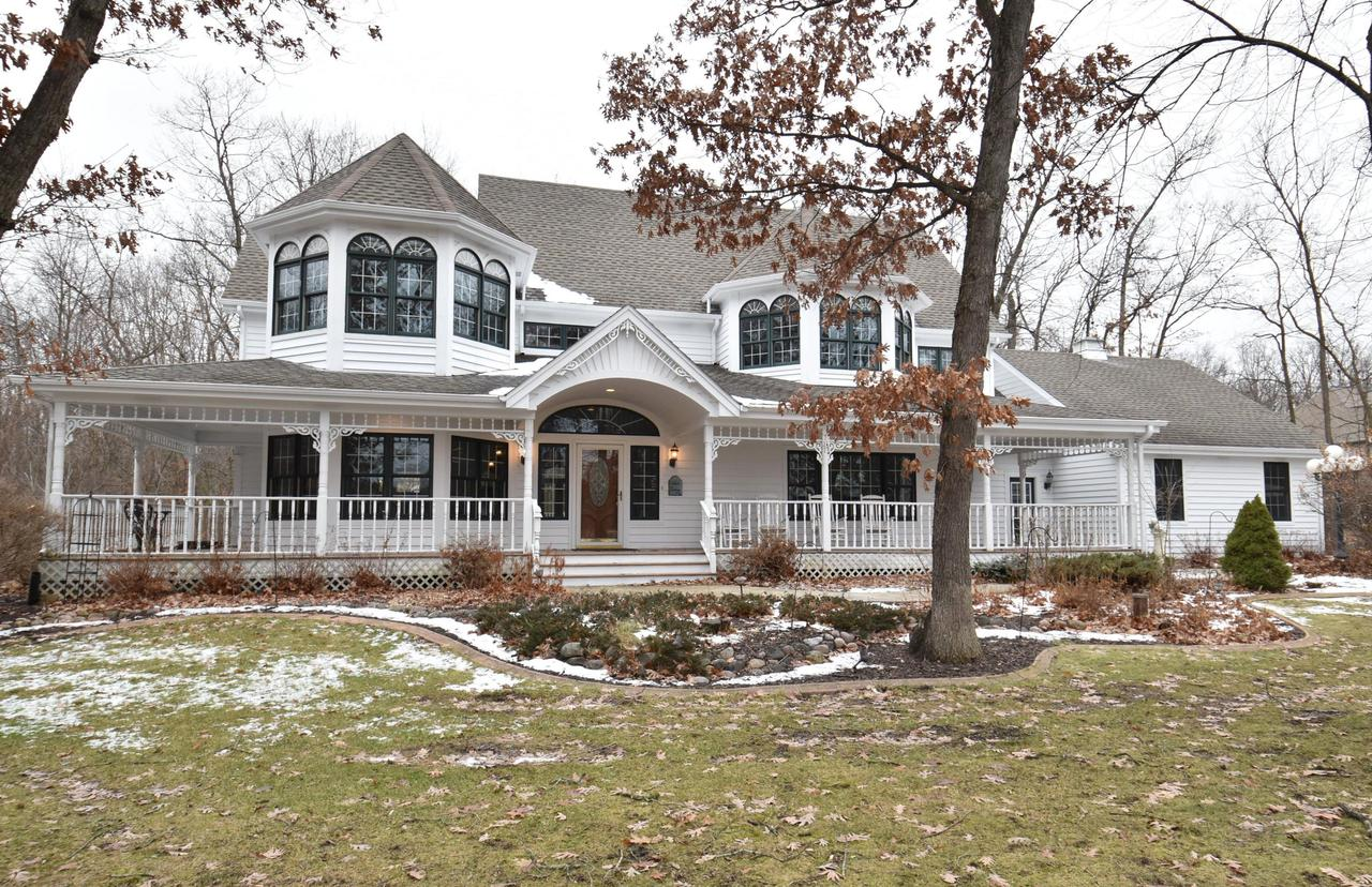 Priced just BELOW the 2019 assessed value and located in YORKVILLE. Stunning custom home on 1.25 acres. This 5 bedroom, 3 full, 2 half bath home offers a perfectly laid out floor plan. Surrounded by nature with seclusion and tranquility. Easy access for the Chicago/Milwaukee commuter. Upon entering you will appreciate all the amenities you expect in a luxury home. Exceptional updated kitchen with walk-in pantry. Split second floor includes a bright master suite with updated bath, walk-in closet and dramatic ceiling lines. Three additional upper bedrooms.  First  floor bedroom and full bath for office suite, guests, or inlaws. First floor laundry. Cozy up to one of 4 fireplaces.  Great entertainment space in the finished lower level. Enjoy evenings on the deck or expansive wrap around porch
