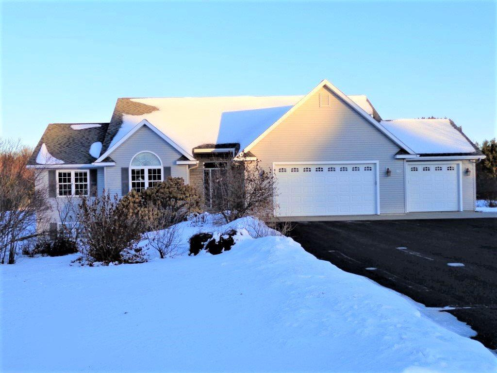 This move-in ready 2005 Parade Home was built by Krupka Construction. Custom designed 4 bedroom ranch on a 2 acre lot in a quiet cul de sac neighborhood. Split plan with volume ceilings throughout. Open concept with vaulted ceilings in main living area and rounded drywall outside corners. Gas fireplace in living room. Transom window over front door and sky lights provide natural light to the main living area.,Kitchen features custom cabinets, large pantry, snack bar open to dining area, matching stainless steel appliances, convection oven and zero radius stainless steel sink with touch technology faucet. Oversized master bedroom suite has tray ceiling, dual vanity, jetted tub and walk in closet. Open staircase to lower level. Downstairs includes a family room, game room, huge 4th bedroom, full bath, storage area and garage stairwell. Finished 3 1/2 car garage. Beautiful landscaping with flowering perennial gardens and stone edging. Country living minutes from the city with garden area, raspberry bushes and orchard with apple and pear trees. Town of Hull taxes.    So many extras!  Home has consistent finishes upstairs and down with bathroom fixtures, tile, light fixtures, six panel Radiata Pine interior doors. Additional amenities include comfort basement heating.  RV storage allowed on site per covenants. Recent updates include brushed nickel door hardware inside, new carpet, new ice maker, Nest thermostat, Rachio wifi sprinkler control system,  horse power garage door opener, almost all new furnace components, 3 ton central air upgrade (Carrier brand),    Please join us at one of the scheduled open houses on Saturday the 11th from 1:30 to 3 or Saturday the 18th from 9:30 to 11, or call us for a private showing.