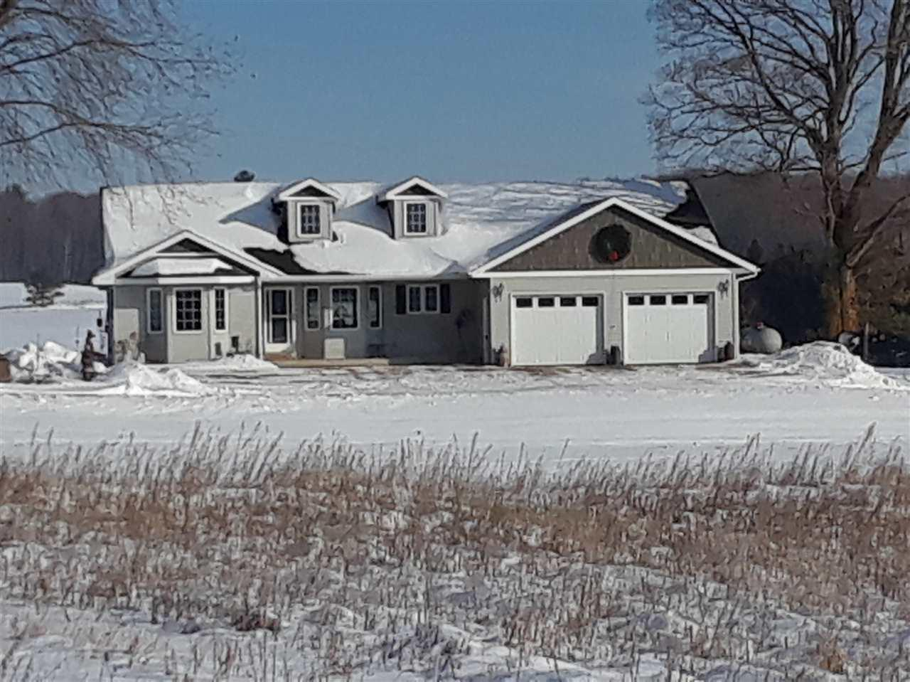 If you have been looking for 10 acres with additional sheds with a beautiful 3 bedroom quality built home you can stop your search now. Come take a look at the LR, Dining Area and Kitchen with Brazilian teak wood floors, open concept cathedral ceiling, gas fireplace and center island. Master bedroom has walk in closet and MBath has jacuzzi and double sinks. The 2 sheds for animals or implements are 40x90 and 24x50. There is a fenced area for horses, etc. Also there is a spring that never freezes for the animals.