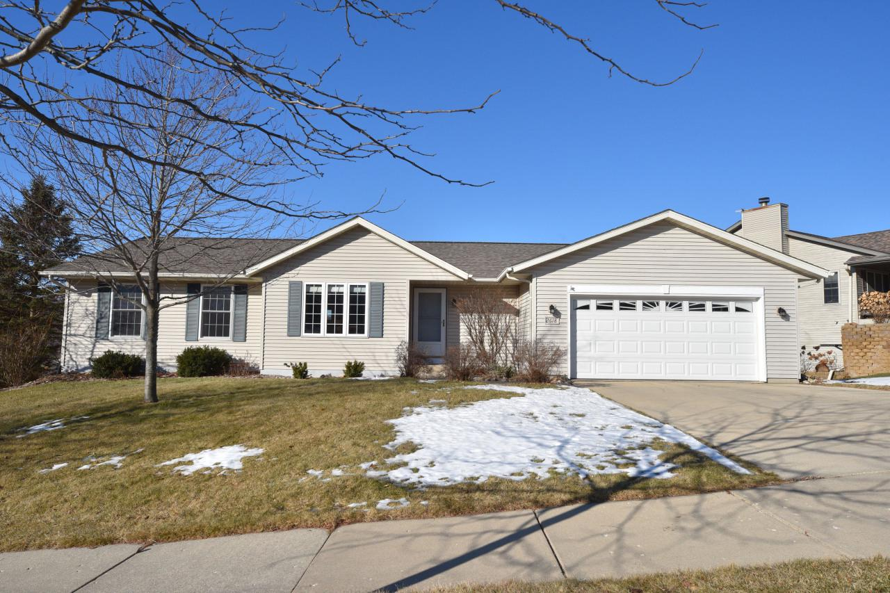 Fantastic views overlook natural area from 2 large decks.  Fully exposed ranch offers 4 bedrooms and 3 full bathrooms.  Large open kitchen with island/breakfast bar.  Fireplaces in the living room and lower level rec room.  Home warranty included for peace of mind.