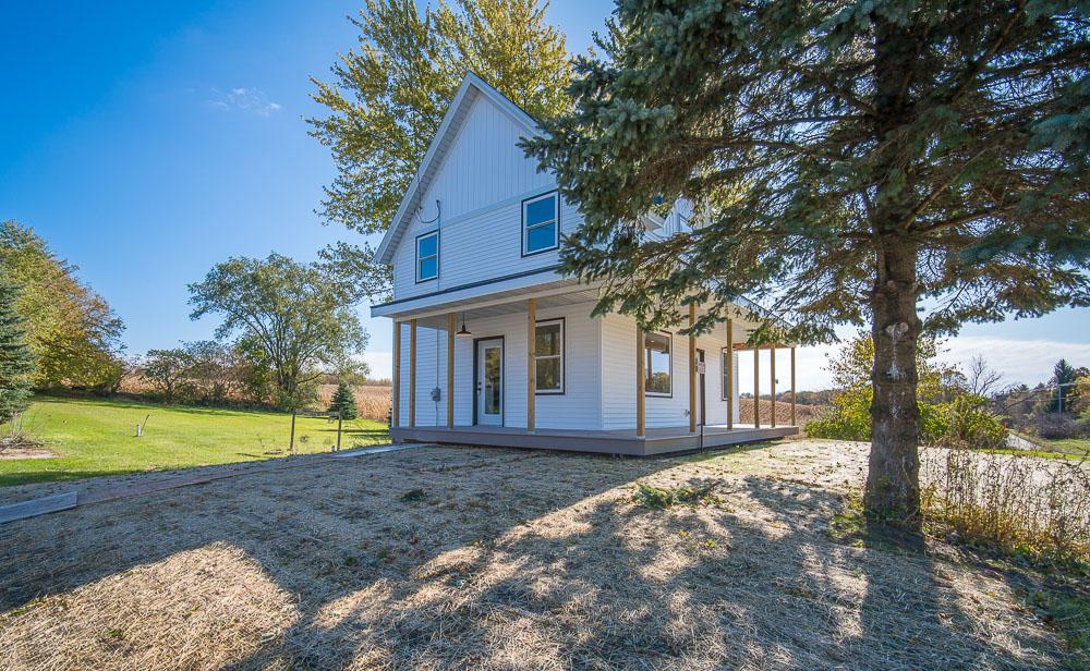 Check out this completely renovated and impressively designed modern farmhouse with huge versatile shop or rental opportunity on site. New everything! Open concept features gorgeous granite throughout, tiled bathroom floors, ship lap, exciting fixtures, stainless kitchen appliances (including a gas stove) and custom metal stair & hand rails. Master bedroom features a tiled shower with custom glass wall & door, dual sinks and sliding track door. Lower level is also finished. Take in your beautiful country views from most of the windows inside, or from the impressive wrap around porch.  Call today to see all this home has to offer!