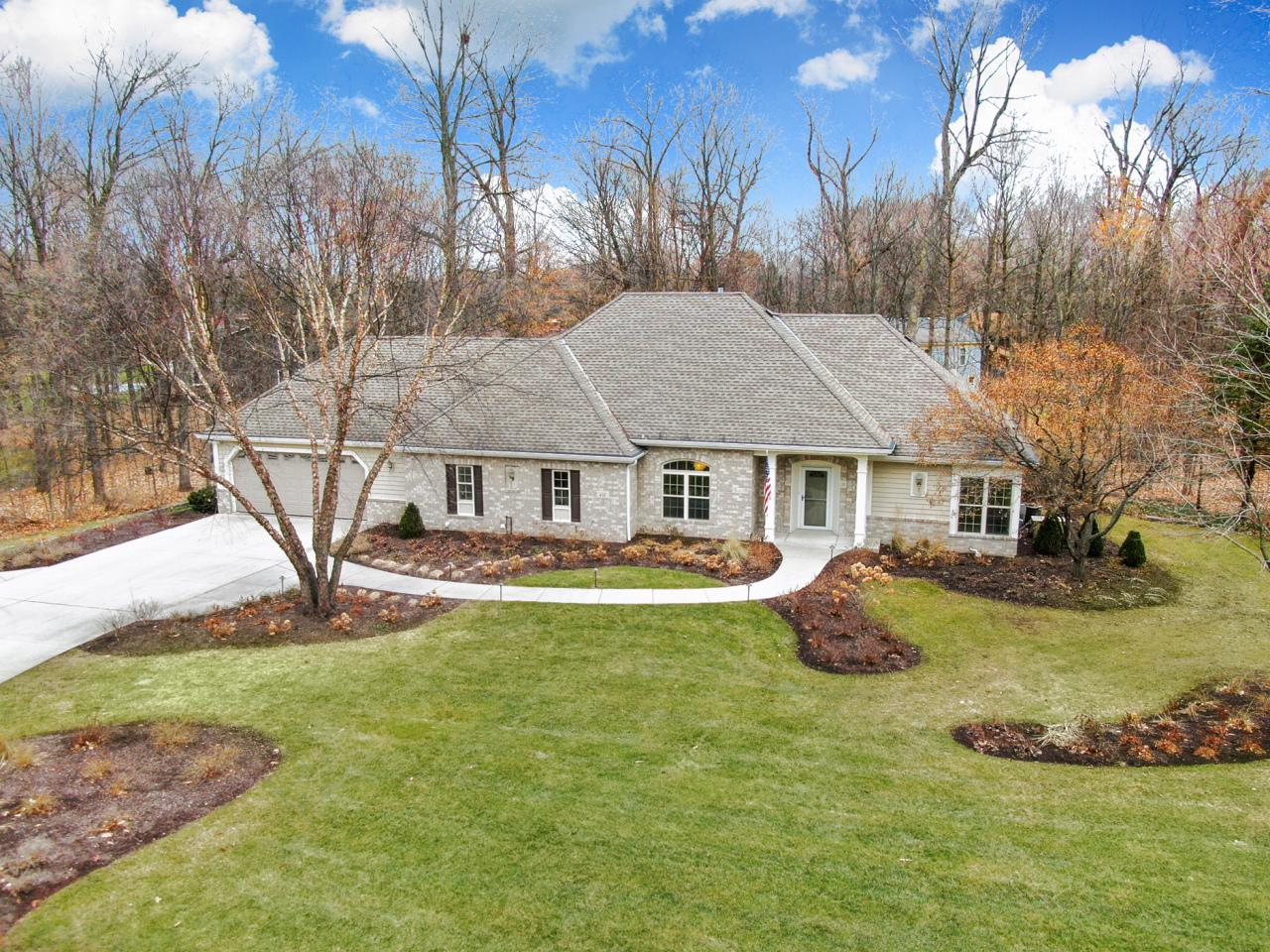 Tucked away in one of Brookfield's wooded gems, Toldt Forest, this beautiful executive ranch is waiting. Walk in and you will be struck by the open concept and large windows inviting views of surrounding forest in. This home has a wonderful flow to it. The gourmet kitchen is the hub with Formal Dining Room, Dinette, Great Room, and Sunroom just a few steps away. A unique Triview gas fireplace can be enjoyed from the Kitchen, Great Room and the Sunroom as well. The Master suite includes ensuite with walk-in shower and whirlpool tub. The lower level features a full bath and bedroom along with a finished rec room with daylight windows. There are many updates to this wonderful home, most notably a newly professional landscaped yard with underground sprinklers.