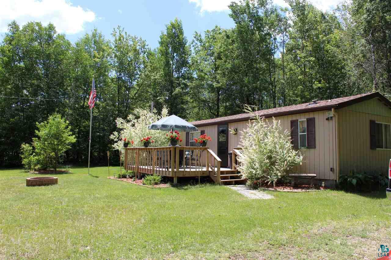 """If you're looking to find """"home base"""" for your Northern Wisconsin adventures, this might be the spot for you. Enjoy the convenience of one-level living while having the opportunity to take in the wildlife and rural scenery that this property provides. The roof, siding, well pump, and treated deck are a few of the recent updates to name. This property sits on 5 acres, just over a mile from the nearest boat landing where you've got access to the Eau Claire Chain of Lakes among others. Seller would prefer to leave property furnished with sale, so all there is to do is move in!"""