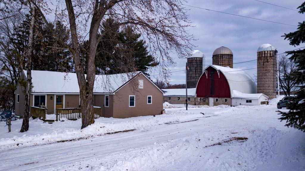 Bring your animals....cows, beef, horses or an ideal set up for Maple syrup production.  Beautiful 5 acre hobby farm with several outbuildings. Home features 3 bedrooms/1 bath and Laundry on main level.  Bright and open kitchen, dining and living room. Improvements: vinyl siding/Blown R50 value insulation, new windows (2yr), roof, wood stove, new steel roof on barn. Working milking system is in place, hay elevators, 3 silo un-loaders and barn cleaner. An additional   pole shed and 2+ detached garage.  Enjoy relaxing on the wood deck off of the living room or the brick patio and firepit, Several fruit trees and beautifully landscaped. Sellers would consider use of additional 50 acres land for pasture.