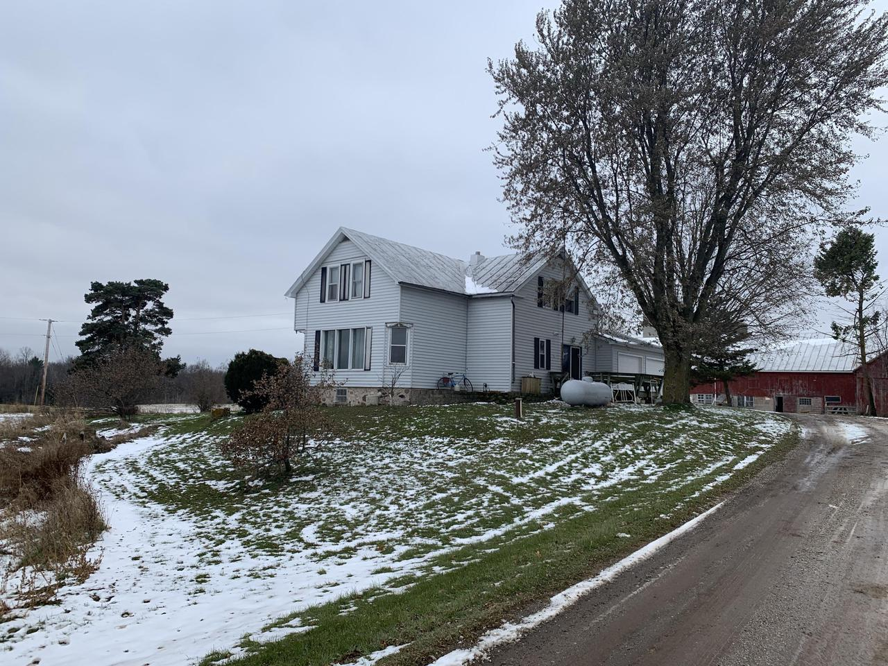 Rural Property in Valders School District with storage. The 4 bedroom farm house, with 2 full bathrooms and potential for a 5th bedroom also has a laundry room on the main floor. Property is vinyl sided, has a metal roof on majority of the home, an Attached two car garage, with two garage door openers and access to the laundry room from the garage. Per the seller the property includes a 110 ft x 40 ft barn, 4 silos, 2 smaller barns, a cement -block 40 x 26 out building and a 80 x 48 pole shed. (Parcel will be surveyed for about 5 acres, currently 38.17 acres)