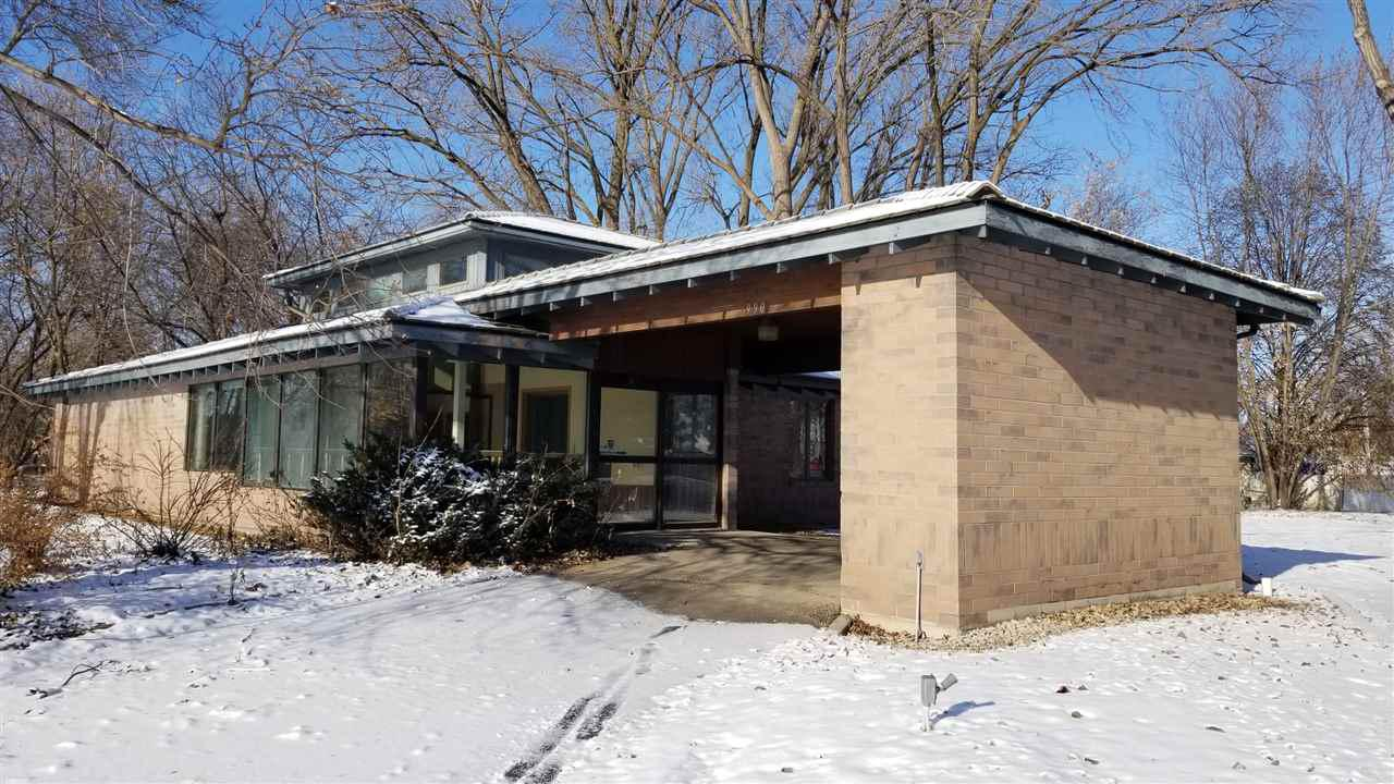 Over 2 acres on the edge and in Menasha Zoned Commercial and Residential With an office building and parking lot already in place. Built in 1982 to last forever entirely constructed of cement. Poured foundation, span create floors and cement tile roof create a low maintenance solid structure and unique soaring design. You can make this unique property anything you like. Rezone or Keep Commercial, the 2 additional lots are Zoned Residential and may be accessible by off Plank Road access to create some pretty impressive build able lots. Would be great for a Cool Home, day care, office, oetc.
