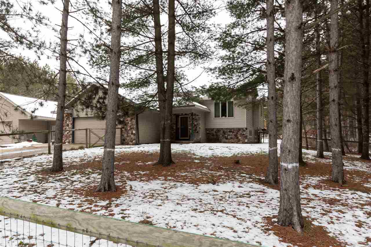 4 bedroom, 2 bath, bi-level on 5 wooded acres.  40x40 detached garage, 30x50 garage with bar and hot tub.  24x36 2 stall horse barn.  Pool with deck surround.  Properties like this are seldom found.  Come check it out.