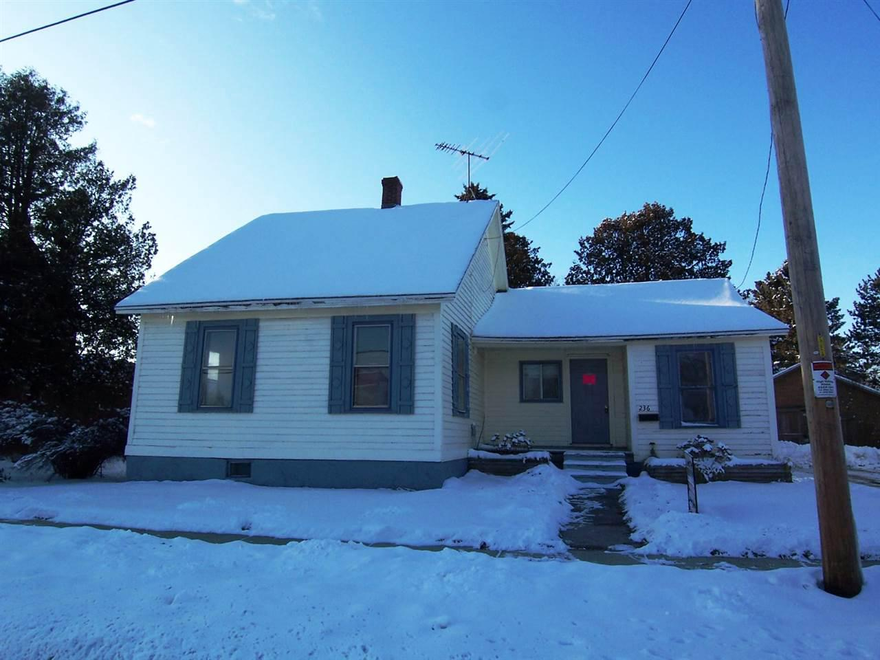 WHEDA foreclosure! Ranch home featuring 3 bedrooms and 1 full bath, spacious eat-in kitchen, living room and a family room, enclosed back porch, full basement, detached garage, and a large open backyard.