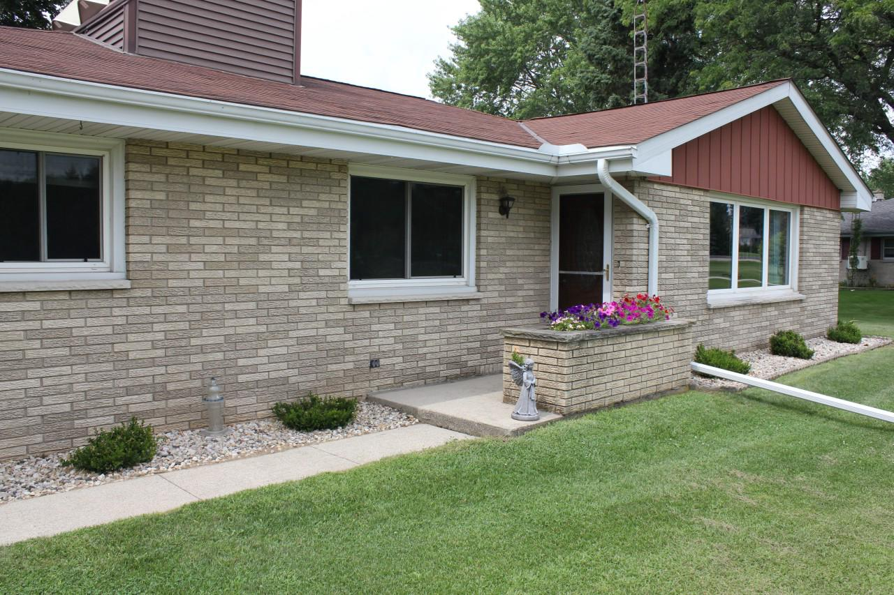 This well maintained move-in ready brick ranch is located north of Kewaskum, just into FDL County.  Situated on nearly an acre, the yard has lots of room for outdoor activities.  You'll find a spacious storage shed along with a 2 1/2 car attached GA & an extra parking space along the level driveway.  3 nicely sized BR's  on the main level create an efficient floor plan minimizing the steps.  The home has a new furnace (2019) & newer kitchen/dining room flooring.  The partially finished basement has an area that was used as a woodworking shop & another kitchen area.  The home has a solar unit that lowers the utility bills by assisting with the heating of both the hot water & heating the home.  The adjoining .83 acre lot is also for sale giving you the opportunity to double your lot size.