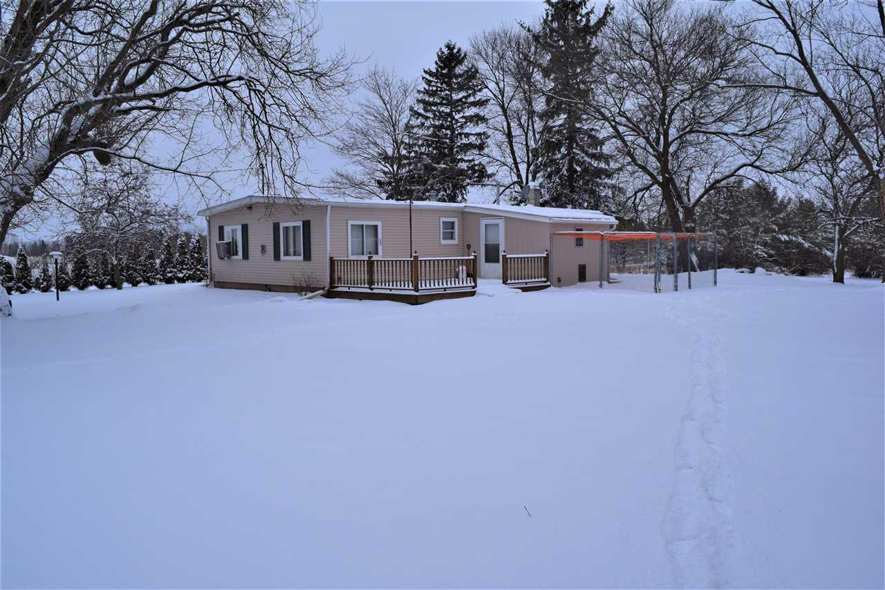 2 acre property west of Kewaunee has so much to offer, no neighbors in site! 3 bedroom, 1.5 bath, partially finished basement with bar and rec room. First floor laundry, sauna, and free standing pellet stove in living room. 3 stall brick garage with heater and new metal roof. Very large barn which is in great shape, will make great storage or even a hobby farm. Newer siding, insulation and kitchen appliances included. Black walnut trees and a mixture of other mature trees. Per seller: Home can be heated by forced air gas furnace or pellet stove or both.