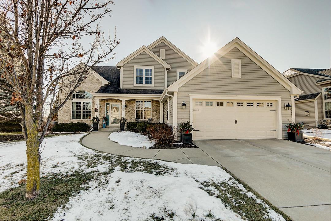 This beautiful 3200 sq ft + home in Rivers Crossing is move in ready. You will enjoy open main level layout with light filled rooms w/HWFs and scenic views of spacious fenced back yard of Conservancy and Fox River. A volumed ceiling in Foyer/Fam. Rm opens to a big Formal DR. The open Liv. Rm w/ HWFs Gas FP has scenic views.  A private Den and Half BA are just off the Liv. Rm on one side and open Kitchen/Dinette on other with large island and walk out to recently redone deck with maintenance free decking and rails. The mudroom leads to a stylish Laundry that includes a Pedestaled Washer/Dryer with sidekick washer. The open staircase leads to 4 BRs which boasts a large MBR Ste. with big WIC and updated bath. Lg. finished LL includes full windows, bar and Full BA. Close to park and schools!