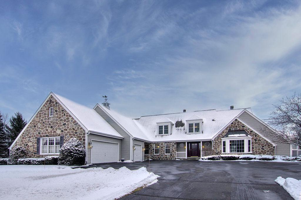 Stunning custom cape cod tucked away on a private road in the Town of Cedarburg! Walk right in and relax in this refreshed move-in ready home. Enjoy the luxury of the 1st floor master with private den, updated spa bath and over-sized walk-in closet. Spa bath boasts shower with upscale tile and double heads, 2-person jetted tub and double vanities. Separate dining room leads to light filled family room with NFP. Updated eat-in kitchen with stainless steel and double oven. Unwind on the deck during the warm summer days, after a dip in the stunning heated in-ground pool.  Attached 3 car heated garage and additional detached 2 car garage for hobby enthusiast. Not often do you find all of this, on a private wooded 6-acre lot just minutes from the hustle & bustle of charming downtown Cedarburg!