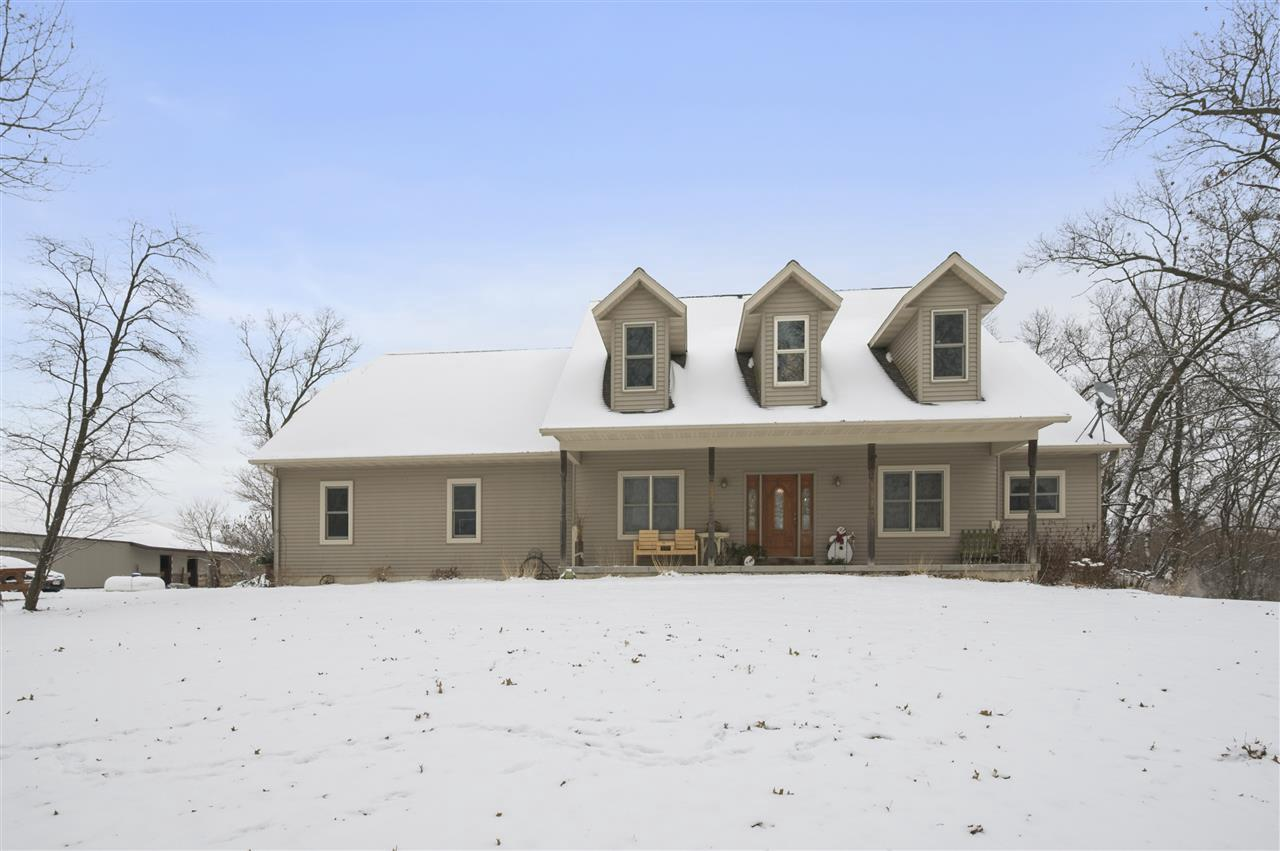 """No Showings till 2/1. Do not miss out on this opportunity to own this one of a kind home, bring your horses, cattle, or all your toys. This 6 bdrm & 4 bath home is built well with 2x6 and also includes 9"""" ceilings & 7"""" doors through out home. Mother in Law suite located in the basement with private access from garage and also includes a walkout basement. This home sits on top of a hill over looking almost 18 acres of woods and pastures where your horses or live stock can graze. A 60x100 indoor Riding Arena, 18x100 Stable Area with wash rack and also includes an Outdoor Riding Arena. Value Range $649,900-$699,900"""