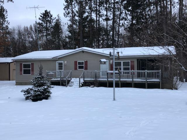 Near so many lakes.  Your boat will never rest.  Walk to Pickeral Lake, trailer to others.  This 3 bedroom, 2 bathroom home is in very good condition.   Cathedral ceilings, skylights, and nicely decorated.  Wood deck, enclosed porch.  Attractive yard area.   Large insulated garage.    Horseshoe pits.  Easy drive to White Potato Lake or High Falls Flowages.   Simple ATV & Snow Mobile trail access.