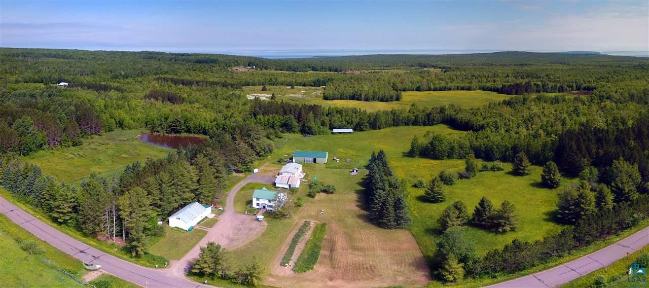 What more could you be looking for? Set on a peaceful 80-acres, this historic home has everything. 3 bed, 1 bath traditional country home. 3-car garage with workshop and fitness room, shed with humidity control room for storage, pole building, chicken coop, old timber mill and much more! Two large fenced garden areas with electric capabilities. Trails throughout the stunning hardwoods. Great spaces for a hobby farm with outbuildings, chicken coops, fenced areas, and a pond. Fruit galore - apples, pears, raspberries, blueberries and strawberries! Brand new septic system in 2017. Don't miss out on this country charmer and schedule your showing today!