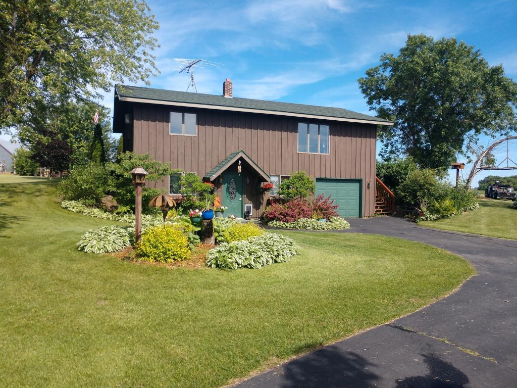WONDERFUL HOBBY FARM.  Come and enjoy your hobby farm with 20 acres that includes Rush River frontage that connects to 122 acres of DNR land.  Your new hobby farm includes horse barn with stalls, a 60x40 indoor and a 90x120 outdoor riding arena.  Home has a separate 32x40 garage with shop that is insulated and heated.  Great location for commuting.  COME SEE TODAY!