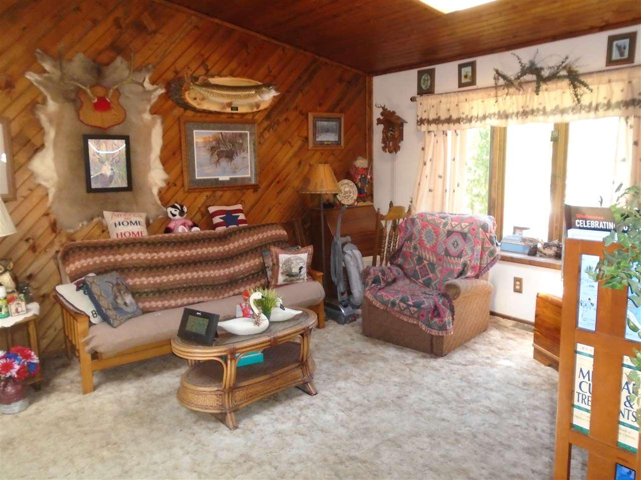 "Lovely rural setting. Resting on two adjoining lots, you will find this immaculate and well cared for home. This 16x80 3 BDRM 2 BA manufactured home offers nearly 1600 finished square feet including a beautiful family room addition. Sale includes all appliances and most furnishings. Factor in not 1 but 2 garages for all your toys, a paved horse shoe driveway, as well as a ""park like"" manicured lot and you will see a property in absolutely move in condition. Bonus-also includes a nice screened room."