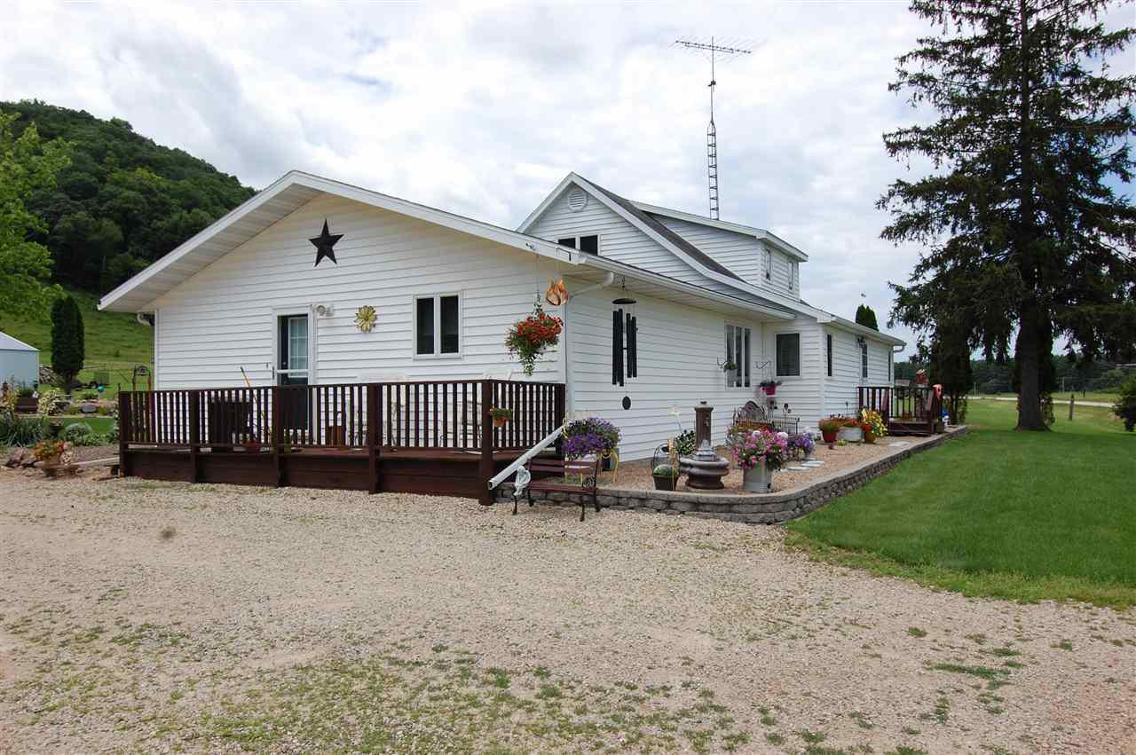 Horses, cows, goats, bring all the animals! Lovely Farmstead in the Wisconsin River Valley features 3 beds, 3 full baths and has an open kitchen, dining and living room.  Basement has family/rec room with an additional bonus room.  Lots of storage on all levels.    NEW 2019 improvements, Large colored concrete patio and new entry deck into house along with new septic system (tank and field) along with a new asphalt shingle roof.  This farm also features a 38x72 Shed and a 30x50 Barn and is presently used for a small herd of beef cattle.  Relax and enjoy the views while munching on grapes, raspberries, apples or anything from your own garden. Across the road lies DNR Lands with access to WI River. Lots of wildlife abound this property for your enjoyment.