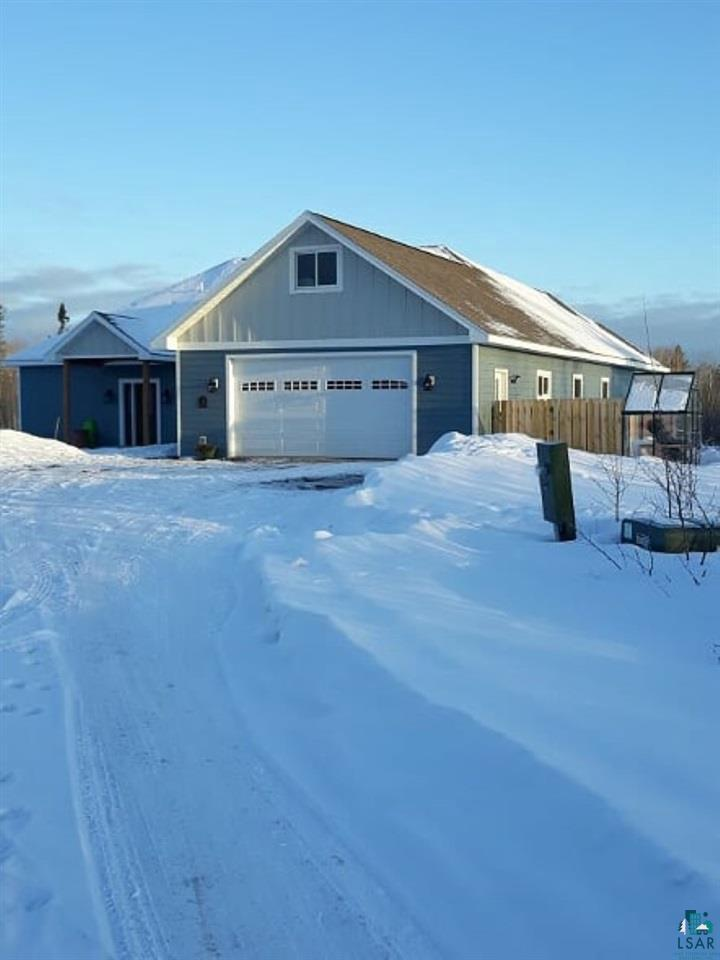 """This Rare Opportunity is yours! Don't hesitate. On Hwy 13 Between Dutchmen & Amnicon River, you will find 34+ Acres with this """"Next to New"""" (2016) 4BD 2 1/2BA home attached 2 car garage with an upstairs bonus room. The finished garage has the 12 x 20 bonus room, the utility room with on demand in floor propane heat. There is a dog kennel under the stairs and a dog door exiting to a fenced run area. Enter through the garage to a laundry room on the right with cabinets, counter space & a spot for a utility tub.  Ahead you will find a coat closet before you enter the great room.  To your left is a playroom or formal dining room.  The 9x10 foyer has a beautiful door & large front closet.  The great room includes the living, kitchen and breakfast area.  Beautiful granite island with stools, soft close cabinets & drawers. Stainless appliances, gas stove & pantry cabinet with pull outs.  There is a sliding door off the living room to a large concrete paver patio out back.  one end of the home has 3 Bedrooms and a full bath with linen closet.  Large closets in each bedroom & plenty of light and ceiling fans. The other end of the home is a 1/2 bath for guests and the master suite, which has a sliding glass door to the patio out back too.  Enjoy your tiled 4 piece master on suite with two walk in closets with closet designs built in. There is a separate toilet room, spa tub, tile shower, and granite double vanity.  Bring your landscaping books and start planning your beautiful yard in the spring. This is a home you will want to make yours."""