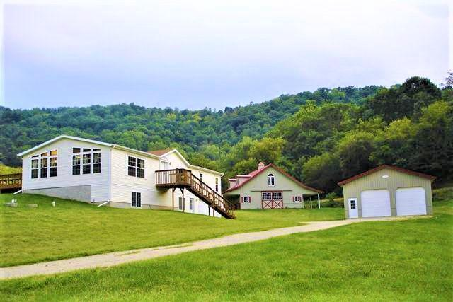 Country Home & Buildings La Crosse County! This 4 bd, 2 ba home on 35 Acres has all the desires you could ask for in a property being nestled in off a dead-end valley road. From hunting, horses and storing all your personal toys. The 36x36 horse barn built in 2005 hooks up to 5 Acre Pasture. 4 Horse Stalls with doors outside, 2 large sliding doors and water available. A 30X46 Pole Building with a concrete floor with two large overhead doors with openers to meet your storage needs. This area has high populated deer count with year to year success especially from this property. Great trail access throughout the property will multiple stand locations and food plot locations. Old growth Apple trees located on the Eastside of the property. 6 mile to Valley View Mall5 miles to Woodman