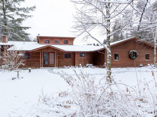 Welcome home to over 6 acres of privacy! Horse lovers look no further! Seclusion at it's finest as you watch deer, turkeys & wildlife roam your backyard from your updated massive deck.  Cozy up to either of your fireplaces on these chilly nights. Master suite complete with walk out to the balcony. 73'x32' barn features 8 large stalls, 5 with outdoor access, tack room and an insulated 120'x50' arena. Just minutes from School Section lake and the public launch. This is what you have been waiting for! Don't miss out on this beautiful unique paradise!