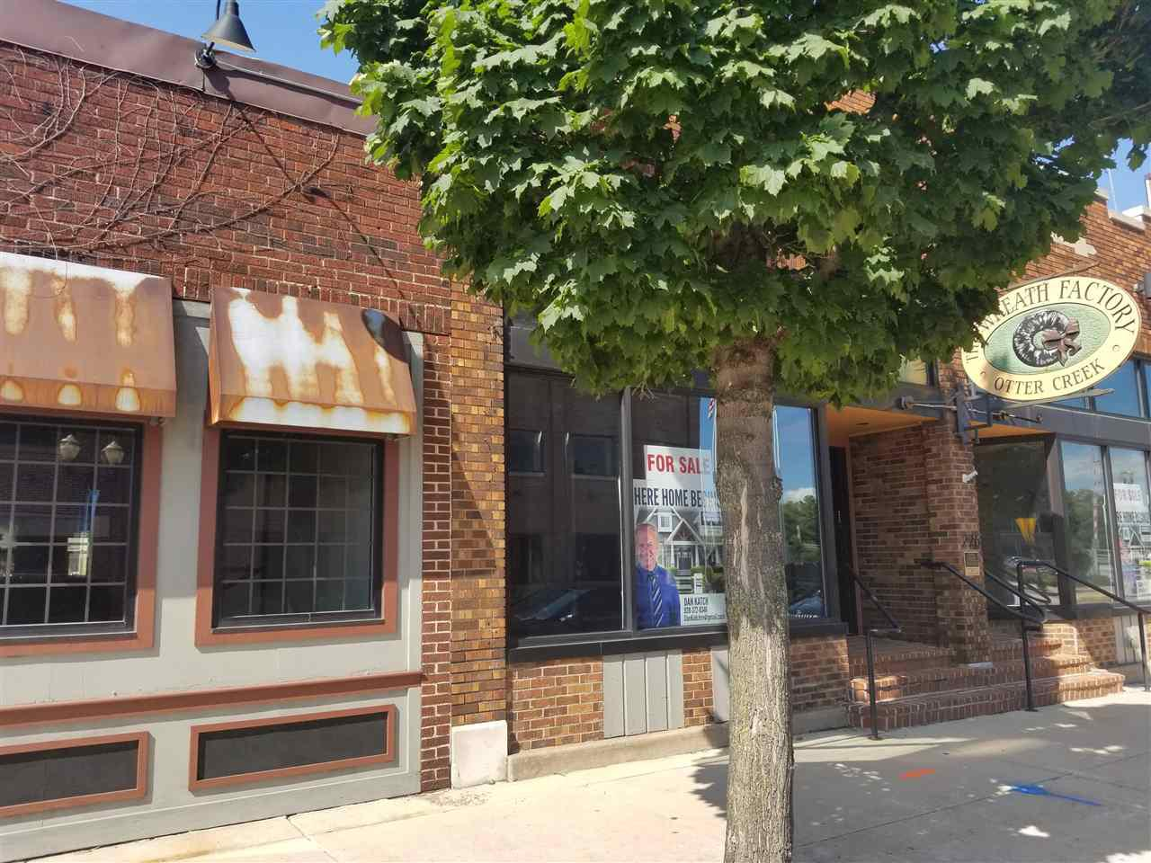 ( $10,000 cash at closing incentive for an accepted offer before 2/28/2020.)  Formally The Wreath Factory. Located in Menasha's Historic Revitalization Downtown Area. This property is a combination of 2 buildings 222 and 226 Main Street in Menasha. Includes private walk through from public parking on Broad to Main Street. Walk-through is gated with brick courtyard. Updates include Rubber roof, Windows, Brick Courtyard. Electrical and more. Full basement. Buildings can be separated if desired. Brick Courtyard has endless Potential. Get on board with the new Menasha Downtown Business Train.