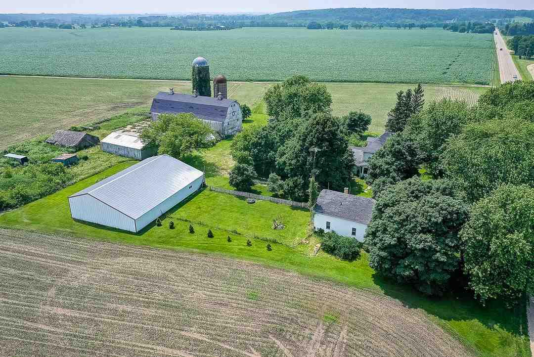 "Mark Twain once said, ""Buy Land, they're not making it anymore.""   How true that statement is!   Rare opportunity to purchase family farm of 61 years with 160 prime agricultural acres.  Approx 140 acres of tillable land and 20 acres of woods.  140 acres are currently rented for $250.00/acre on a year lease.  2 farm houses are on parcel B D 1100007. Main house with 5 BR and the rental house with 3 BR. Plenty of opportunity for additional rental income.   There are 3 parcels with this property.  Large 102x36 barn, 60x90 machine shed, and several outbuildings for all your storage needs.    Act now, never a better time to purchase farm land for the future."