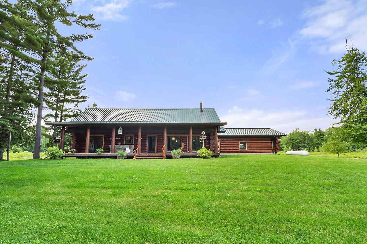 Only 20 minutes North of Green Bay is an Extraordinary Log home on 76.8 acres on the Pensaukee River. Home features 5 Bedrooms, 3 Baths, gorgeous floor to ceiling stone fireplace, custom ornate front door, front & back covered porch, stone trim, Hickory cabinets, slate flooring, Fully Stocked Pond, Large Outbuilding with Horse Stalls & Pasture. 55 Acres of MFL has Maple, Oak, Pine and Cedar Trees. Grab your fishing pole and head out in the kayak, go for a hike, or enjoy a ATV ride on the many trails. Excellent Hunting Land right in your Back Yard.  Secluded Property with So Much to Offer!