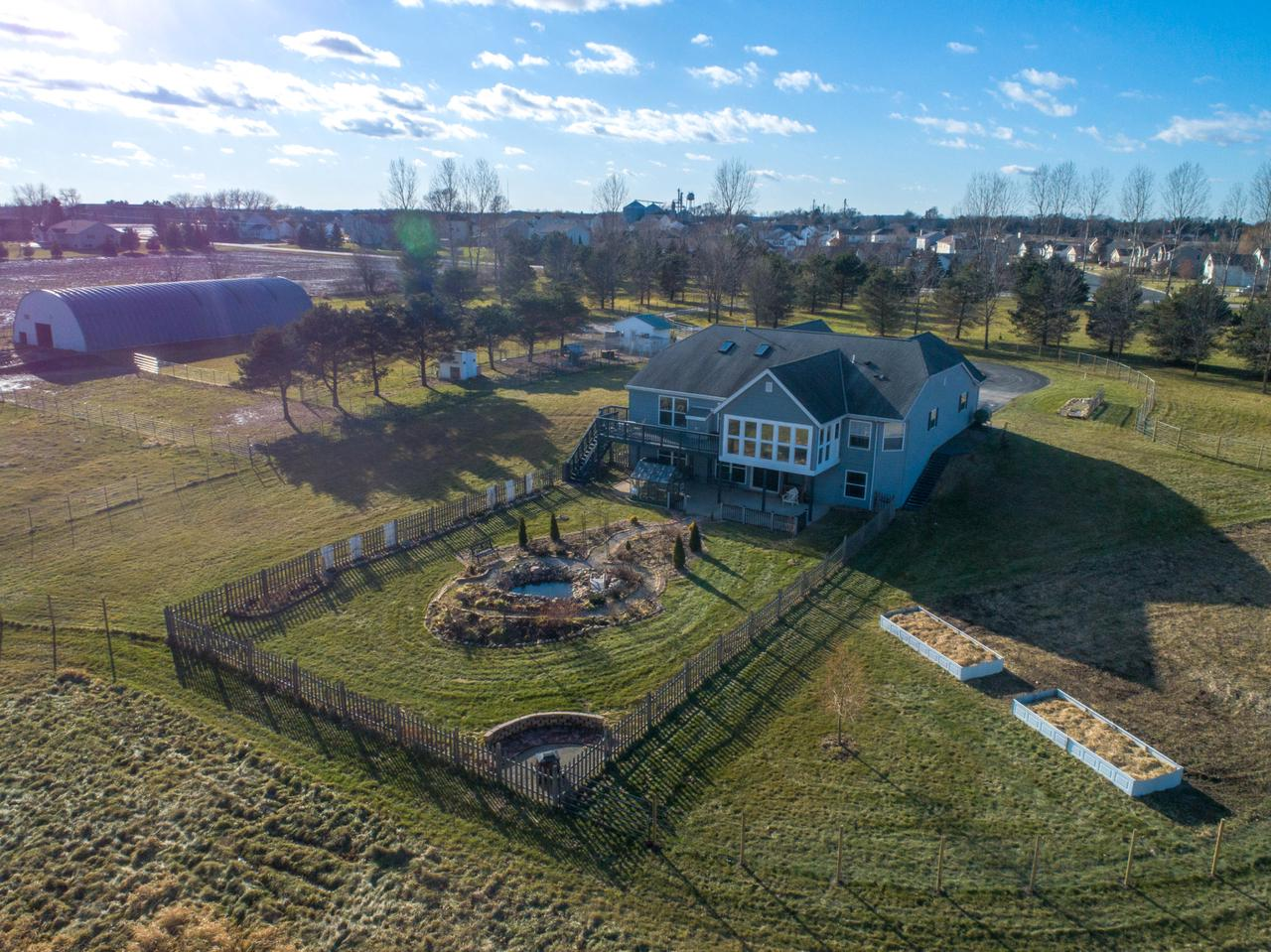 Covenant Acres Farm. Beautiful open concept home with walk-out basement on over 20 acres. 5,000 sq.ft. barn w/heated tack room, stalls, electric, water and second septic system.  2 addtl outbuildings, greenhouse. 2 ponds, 4 natural springs, hay field, trails, fire pits, perennial gardens, fruit trees, garden plot with raised beds. Home features skylights, vaulted ceilings, leaded glass doors, Moroccan stone tile and wine cellar. Stunning countryside views . Multiple entertainment areas. Extensive updates throughout home incl low watt and LED lighting,  finished lower level w/kitchenette suitable for in-law suite. Bring your horses, chickens and other livestock to live on this very well maintained property and enjoy mother nature at its best. Great hunting grounds. 1 Year Home Warranty incl
