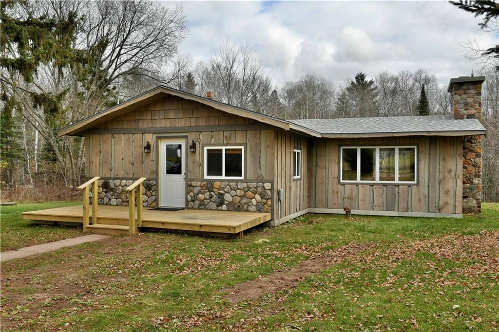 Hunters Haven! This recently updated 2 BR, 1 BA home w/ 23 acres provide fantastic hunting and a plethora of outdoor activities. Home has updated Hickory cabinets, counter tops, vinyl laminate flooring, new water boiler and exterior. Clean and tidy with a wood burning fireplace for cozy nights and large deck for enjoying wildlife. ATV or snowmobile from the front door to ride miles of trails or explore the wooded acres out the back door. A 2 stall garage provides storage for the toys.