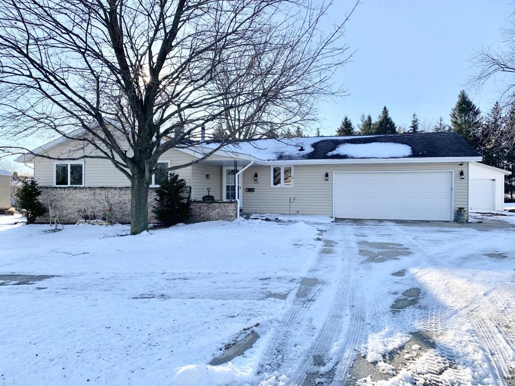 The search is over - come see this ranch in the village with so much to offer. NEW KITCHEN with Amish-built cabinets. Spacious rec/family room in the lower level plus a half bath. Spend winter days relaxing in the sunroom overlooking your backyard, but in summer head out to your big deck shaded by large pine trees providing you privacy. There's plenty of yard to throw the ball around, but if you want more space, walk through the pines to the new park! If you need storage, you'll have it: spacious utility shed, 1.5 car detached garage with concrete floor, PLUS a hobbyist's-dream 2 car heated attached garage, and plenty of parking too! On a quiet cul-de-sac, but only a minute to Hwy 45. Everything you've been looking for! New solid 6 panel doors and all new carpet.
