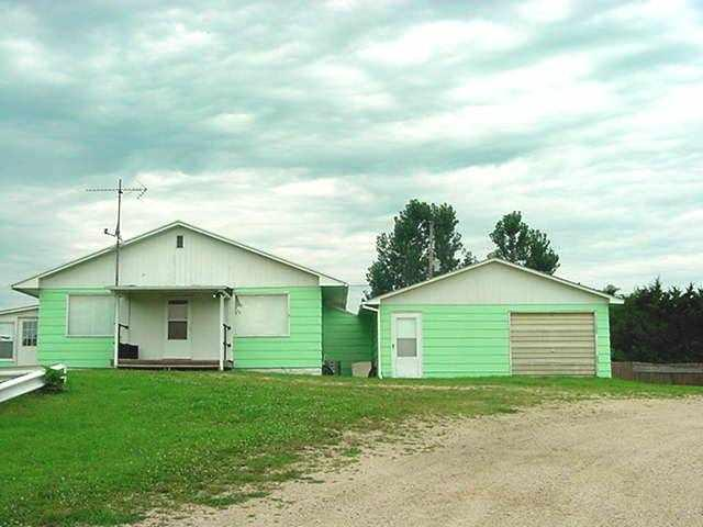 VALUE doesn't get any better than this!  2 Bedroom, 1 1/2 Bath, ranch style home, has a large living room, family room, dining room, eat in kitchen, a 3 season porch and all appliances are included.  There's an attached garage and an additional 24x32 storage building.  Horseshoe driveway for easy access.  Newer Septic and  Well!  *2nd Parcel # 006-00944-0000*