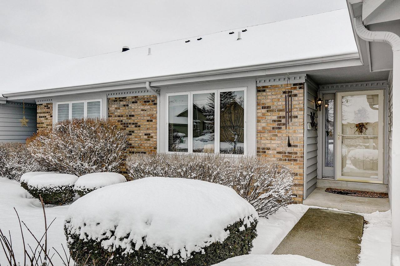 This bright, cheery, meticulously maintained, updated 2 bedroom, 1.5 bath side-by-side ranch condo in the very popular Riversbend community awaits its new owner!  Inside you'll find a remodeled kitchen (2015), completely updated bathrooms (2019), and a spacious, cozy living room with gas fireplace that has a  programmable thermostat (new in 2018).  In the warmer months, enjoy your favorite book and/or beverage on the newer back deck with SunSetter retractable awning.  Clean, dry basement with newer furnace and radon mitigation system (both 2017).   Two beautiful outdoor pools, tennis courts and a clubhouse top it all off.  This development  is tucked away right off County Line Rd close to the freeway, restaurants and shopping... schedule a tour today!  P.S. NO PETS