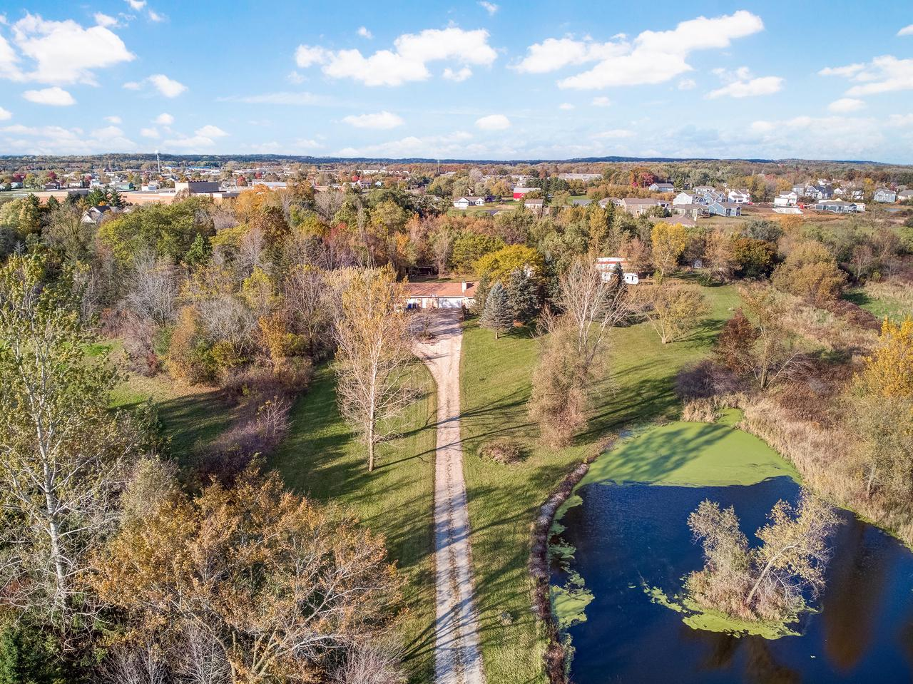 What a great find! Country living at its finest. 9.8 acres and so close to amenities & Muskego High School. 3 bedrooms 2.5 bath open concept ranch w/  5 car attached heated/AC garage with 1/2bath, heated/ AC workshop garage, barn and 2 ponds. Finished lower level, workout room, Den, office space and full bath. Large eat-in kitchen and all applianes included opens to LR w/ NFP. Main floor laundry. ATTN: BOW HUNTERS. perfect land for you.