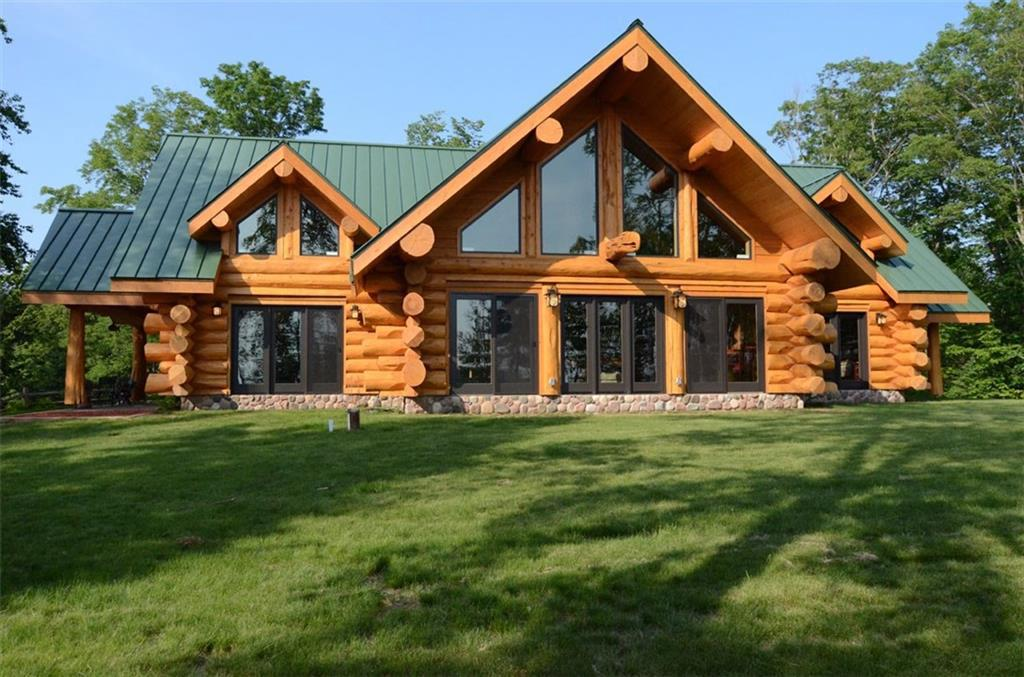 """This stunning 4BD, 3BA, 3,400 sf custom full-log home sits on 1,000 feet of private, peninsula frontage. Built in 2009, the """"Lodge"""" has an open floor plan with a 2 story-rock fireplace, massive cedar log beams, luxury finishings and furnishings, majestic views, sandy beach and much more. The """"Cabin"""", a 2BR, 1BA, 1,000 sf custom full-log home, is equally impressive. EVERYTHING is included, furnishings, decor, boats, snowmobiles, right down to the silverware. Lake Namakagon living at its finest."""