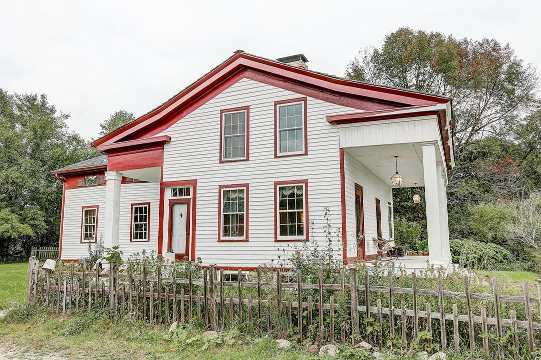 Beautifully rebuilt homestead on 3.68 acres in the Town of Summit. The home was originally built in 1842 but was transferred to this site in 1993-1994, while also upgrading all electrical, plumbing, foundation, etc. to modern standards. The Greek Revival styled home offers 4-5 bedrooms, 3 full baths and over 2,200 sq ft of living space. Cozy up to one of the three fireplaces or enjoy a book on your massive front porch.  The barn provides additional work space and was used to raise sheep. Schedule your showing today and claim your piece of history.