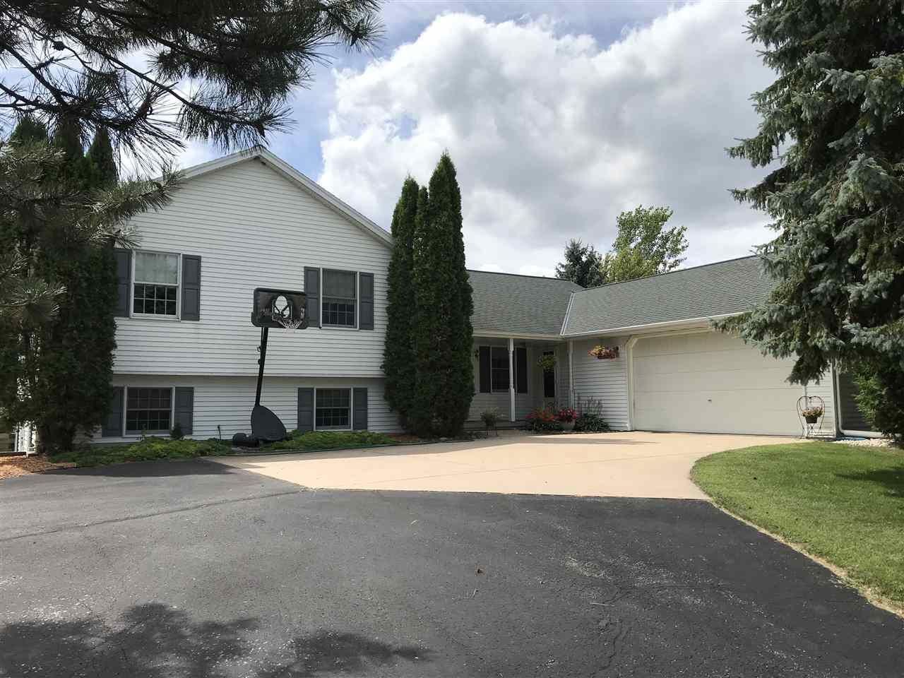 Need space! Come see this 4 bdrm, 2.5 bath custom multi-level country home on 8 acres. Main flr features a beautiful grt rm w/brick FP and tongue & groove ceiling. Kitchen w/maple cabinets & hdwd floors. Relax in the 4-season rm w/tongue & groove ceiling and 3 sets of patio doors. 4 bdrms upstairs including master w/entrance to bath w/jet tub. In the lower lvl there is a spacious frm w/full walk-out to patio. You will also find a bedroom, office & full bath w/laundry. Basement w/garage entry. Want horses? This 8 acre property is ideal!