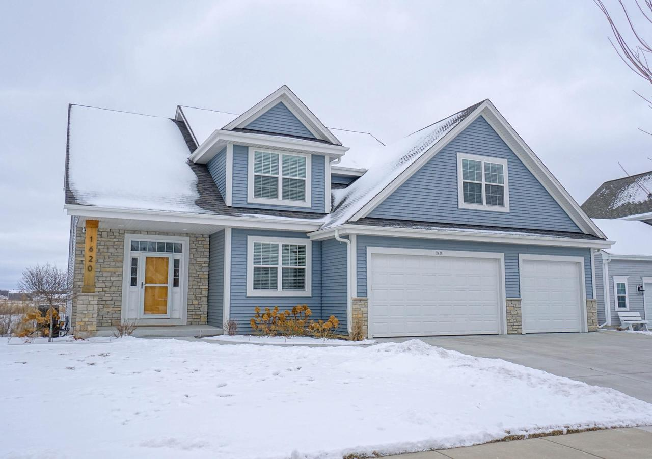 Beautifully designed home in West Bend's Creekside! Enjoy over 3000 sq ft of living space with the beautifully finished lower level. Lots of curb appeal with the partial stone exterior and covered front entrance. Interior boasts open concept kitchen and great room. Kitchen offers quartz countertops, center island breakfast bar, large pantry, and SS appliances included. Additional wet bar on main level. Gas fireplace in great room. Main floor laundry-mud room. Open staircase leads to 4 nice size bedrooms and 2 full baths on the upper level. Master suite has walk-in closet and master bath featuring dual sink vanities and oversized tiled shower. Lower level has a large family-rec room with full size window and full bath. Huge 3.5 car garage. Deck and patio with pond views!