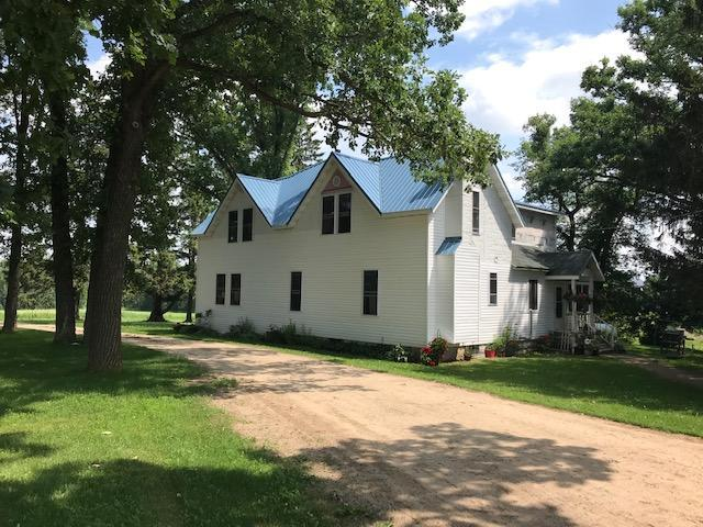 Charming two story updated home - new roof & siding. Spacious room throughout, 7 bedrooms, 2 baths. Hobby farm - barn 112x36, 40x64 pole shed, utility shed, 8x15 3 car detached garage. Huge garden area, room for chickens - fenced pasture for horses or beef. Current owner has sheep, horses & beef cattle. The possibilities are endless. Beautiful yard - newer septic - come take a look.