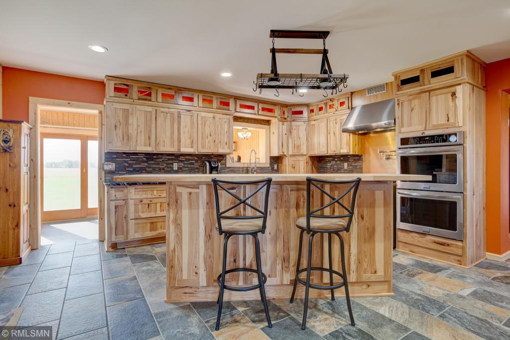 Welcome to the dream! This is extensively updated 5 bedroom, 2 bathroom farm house sits on 7 beautiful acres and is sure to impress. Featuring a stunning kitchen made for a chef with commercial grade appliances, 6 burner gas stove, 3 ovens, commercial refrigerator, high end granite countertops, custom hickory cabinetry with pull out pantry shelving and heated tile flooring. Heated 2 car garage. Spectacular outdoor space with a picturesque 100 year old 13,000 square ft barn with soaring timbers, original silo, and loft area with bar, fully set up for events. Not enough? There is also a 1,200 sq. ft, 2-story shop! So much potential in this fantastic property. Don't miss it!